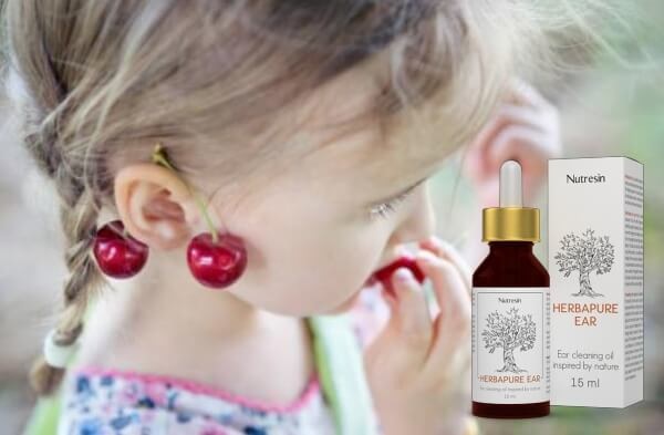 enfant avec des cerises derrière les oreilles et des gouttes de nutrésine